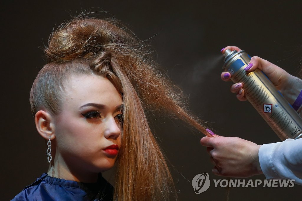 epa05921340 A model gets her make-up done during the annual hairdressers festival 'Crystal Angel' in Kiev, Ukraine, 22 April 2017. The best hairdressers and make-up artists participated in the international festival which takes place from 21 to 22 April. EPA/SERGEY DOLZHENKO