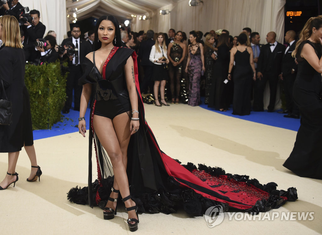 ▲ Nicki Minaj attends The Metropolitan Museum of Art's Costume Institute benefit gala celebrating the opening of the Rei Kawakubo/Comme des Garçons: Art of the In-Between exhibition on Monday, May 1, 2017, in New York