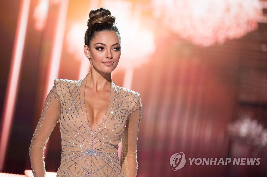 "▲ Demi-Leigh Nel-Peters, Miss South Africa 2017 competes in an evening gown of her choice as a top 10 finalist during The MISS UNIVERSE® on Sunday, November 26th from the AXIS at Planet Hollywood Resort & Casino in Las Vegas, NV. / AFP PHOTO / Miss Universe Organization / Matt Petit / RESTRICTED TO EDITORIAL USE / MANDATORY CREDIT: ""AFP PHOTO / THE MISS UNIVERSE ORGANIZATION / MATT PETIT""/ NO MARKETING / NO ADVERTISING CAMPAIGNS / DISTRIBUTED AS A SERVICE TO CLIENTS"