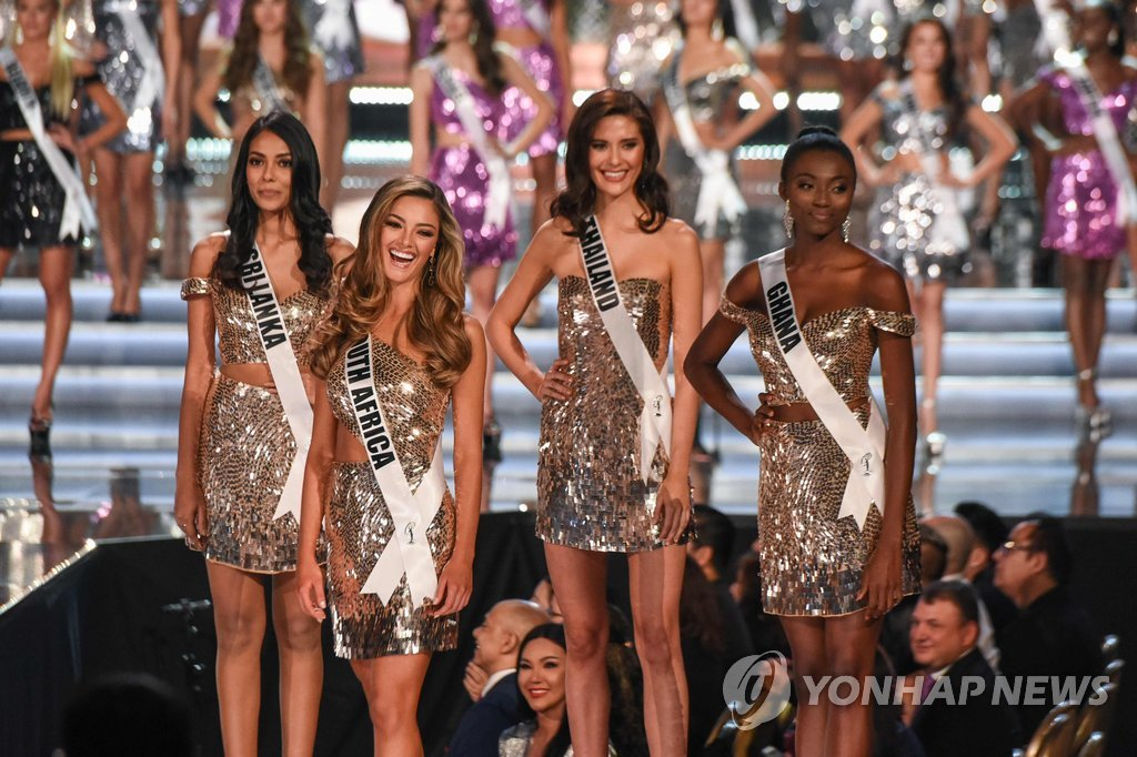 ▲ (L-R): Contestants Miss Sri Lanka 2017, Christina Peiris; Miss South Africa 2017 Demi-Leigh Nel-Peters; Miss Thailand 2017 Maria Poonlertlarp; and Miss Ghana 2017 Ruth Qurashie stand on stage during the 2017 Miss Universe Pageant on November 26, 2017 in Las Vegas, Nevada Beauties from across the globe converged in Las Vegas Sunday, where Miss South Africa was crowned Miss Universe. Demi-Leigh Nel-Peters, 22, edged out her rivals from Colombia and Jamaica to take the crown. Nel-Peters, a graduate in business management, said her disabled half-sister has been among her great