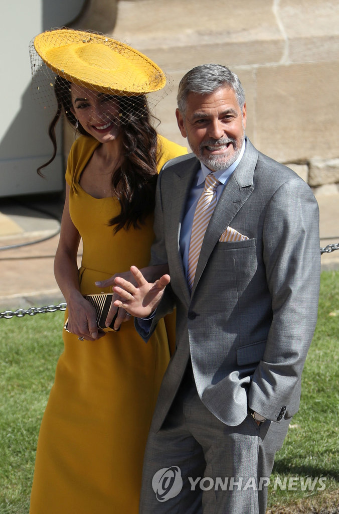 ▲ Amal Clooney and George Clooney arrive at St George's Chapel in Windsor Castle for the wedding of Prince Harry and Meghan Markle. Saturday May 19, 2018. Andrew Milligan/Pool via REUTERS