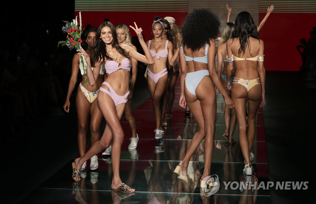 ▲ CORRECTS DATE TO SUNDAY, JULY 15, 2018 INSTEAD OF MONDAY, JULY 16, 2018 - Models walk down the runway during the Montce swimwear show at Miami Swim Week, Sunday, July 15, 2018, in Miami Beach, Fla. (AP Photo/Lynne Sladky)
