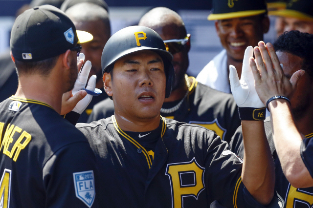 ▲ Mar 10, 2019; Tampa, FL, USA; Pittsburgh Pirates third baseman Jung Ho Kang (16) celebrates with teammates after a solo home run during the third inning against the New York Yankees at George M. Steinbrenner Field. Mandatory Credit: Butch Dill-USA TODAY Sports