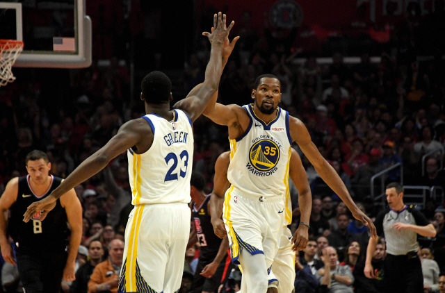 ▲ Apr 26, 2019; Los Angeles, CA, USA; Golden State Warriors forward Kevin Durant (35) celebrates with forward Draymond Green (23) against the LA Clippers in the first half of game six of the first round of the 2019 NBA Playoffs  at Staples Center. Mandatory Credit: Kirby Lee-USA TODAY Sports