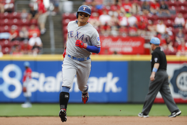 ▲ Texas Rangers' Shin-Soo Choo runs the bases after hitting a solo home run off Cincinnati Reds starting pitcher Sonny Gray in the first inning of a baseball game, Sunday, June 16, 2019, in Cincinnati. (AP Photo/John Minchillo)