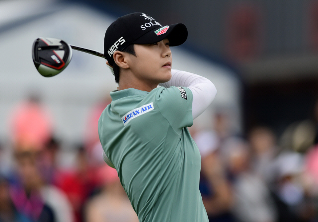▲ Jun 23, 2019; Chaska, MN, USA; Sung Hyun Park watches her shot off the first tee during the final round of the KPMG Women's PGA Championship at Hazeltine National Golf Club. Mandatory Credit: Thomas J. Russo-USA TODAY Sports