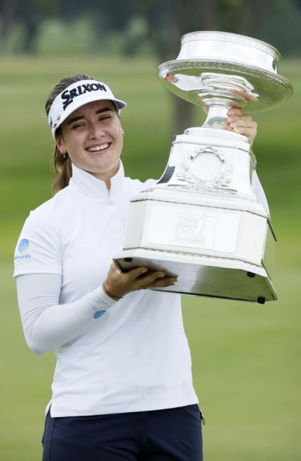 ▲ Hannah Green, of Australia, holds the trophy after winning the KPMG Women's PGA Championship golf tournament, Sunday, June 23, 2019, in Chaska, Minn. (AP Photo/Charlie Neibergall)