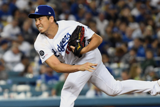 ▲ Jul 19, 2019; Los Angeles, CA, USA; Los Angeles Dodgers pitcher Kenta Maeda (18) pitches against the Miami Marlins in the eighth inning at Dodger Stadium. Mandatory Credit: Richard Mackson-USA TODAY Sports