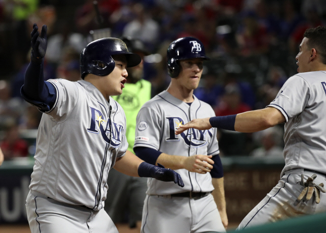 ▲ Sep 11, 2019; Arlington, TX, USA; Tampa Bay Rays first baseman Ji-Man Choi (26) celebrates with shortstop Willy Adames (1) after hitting a three-run home run during the second inning against the Texas Rangers at Globe Life Park in Arlington. Mandatory Credit: Kevin Jairaj-USA TODAY Sports