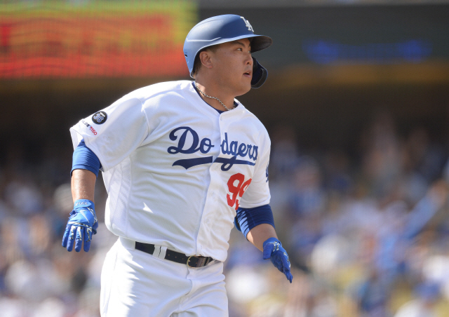 ▲ September 22, 2019; Los Angeles, CA, USA; Los Angeles Dodgers starting pitcher Hyun-Jin Ryu (99) runs the bases after hitting a solo home run against the Colorado Rockies during the fifth inning at Dodger Stadium. Mandatory Credit: Gary A. Vasquez-USA TODAY Sports
