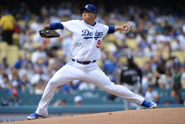 ▲ September 22, 2019; Los Angeles, CA, USA; Los Angeles Dodgers starting pitcher Hyun-Jin Ryu (99) throws against the Colorado Rockies during the first inning at Dodger Stadium. Mandatory Credit: Gary A. Vasquez-USA TODAY Sports