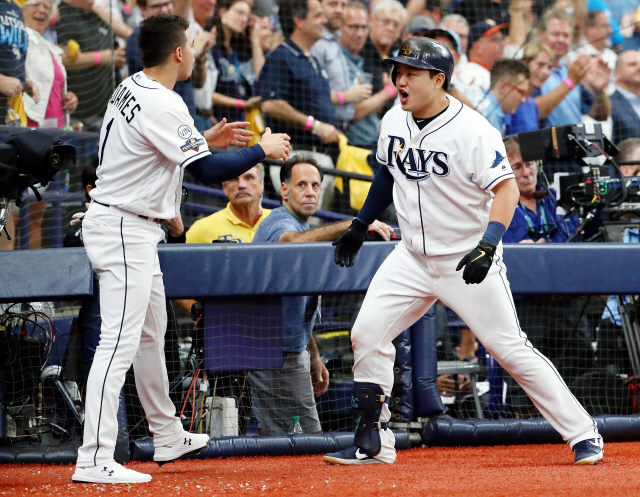 ▲ Oct 7, 2019; St. Petersburg, FL, USA; Tampa Bay Rays first baseman Ji-Man Choi (26) celebrates with shortstop Willy Adames (1) after hitting a home run against the Houston Astros during the third inning in game three of the 2019 ALDS playoff baseball series at Tropicana Field. Mandatory Credit: Kim Klement-USA TODAY Sports