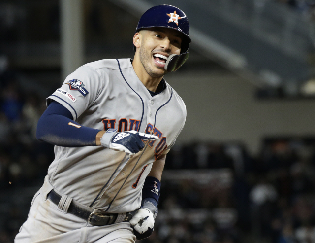 ▲ Houston Astros Carlos Correa rounds the bases after hitting a three-run home run in the sixth inning of Game 4 of the American League Championship Series against the New York Yankees in the 2019 MLB Playoffs at Yankee Stadium in New York City on Thursday, October 17, 2019.  Photo by John Angelillo/UPI