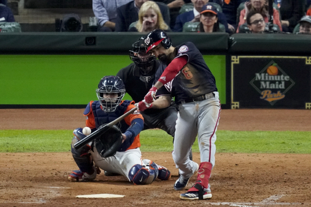 ▲ Washington Nationals' Anthony Rendon hits a home run against the Houston Astros during the seventh inning of Game 7 of the baseball World Series Wednesday, Oct. 30, 2019, in Houston. (AP Photo/Eric Gay)