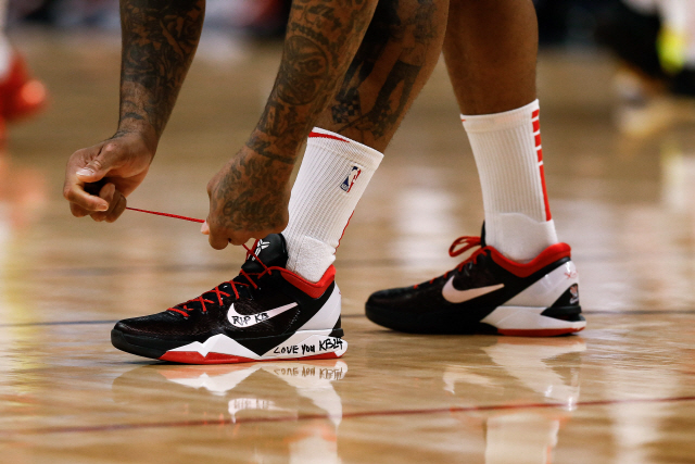 ▲ Jan 26, 2020; Denver, Colorado, USA; Houston Rockets forward P.J. Tucker (17) ties his shoes before the game against the Denver Nuggets the at the Pepsi Center. A tribute for former Lakers player Kobe Bryant is written on the shoes. Mandatory Credit: Isaiah J. Downing-USA TODAY Sports