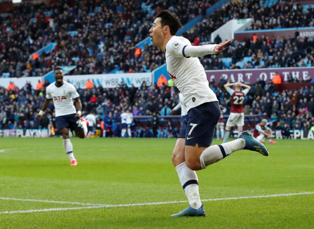 """▲ Soccer Football - Premier League - Aston Villa v Tottenham Hotspur - Villa Park, Birmingham, Britain - February 16, 2020  Tottenham Hotspur's Son Heung-min celebrates scoring their third goal   Action Images via Reuters/Andrew Boyers  EDITORIAL USE ONLY. No use with unauthorized audio, video, data, fixture lists, club/league logos or """"live"""" services. Online in-match use limited to 75 images, no video emulation. No use in betting, games or single club/league/player publications.  Please contact your account representative for further details."""