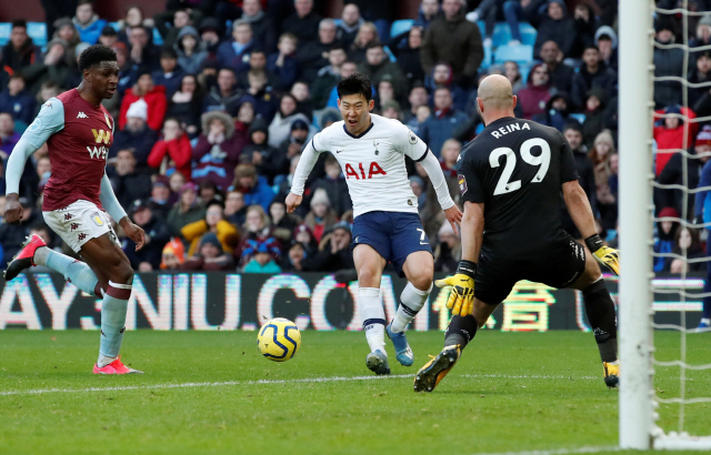 """▲ Soccer Football - Premier League - Aston Villa v Tottenham Hotspur - Villa Park, Birmingham, Britain - February 16, 2020  Tottenham Hotspur's Son Heung-min scores their third goal   Action Images via Reuters/Andrew Boyers  EDITORIAL USE ONLY. No use with unauthorized audio, video, data, fixture lists, club/league logos or """"live"""" services. Online in-match use limited to 75 images, no video emulation. No use in betting, games or single club/league/player publications.  Please contact your account representative for further details."""